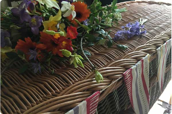 coffin with flowers and bunting